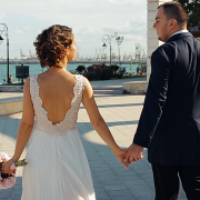 Bride and groom holding hands, wedding day in Constanta, Black Sea coast